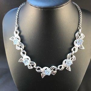 Vintage silver tone necklace with blue rhinestones